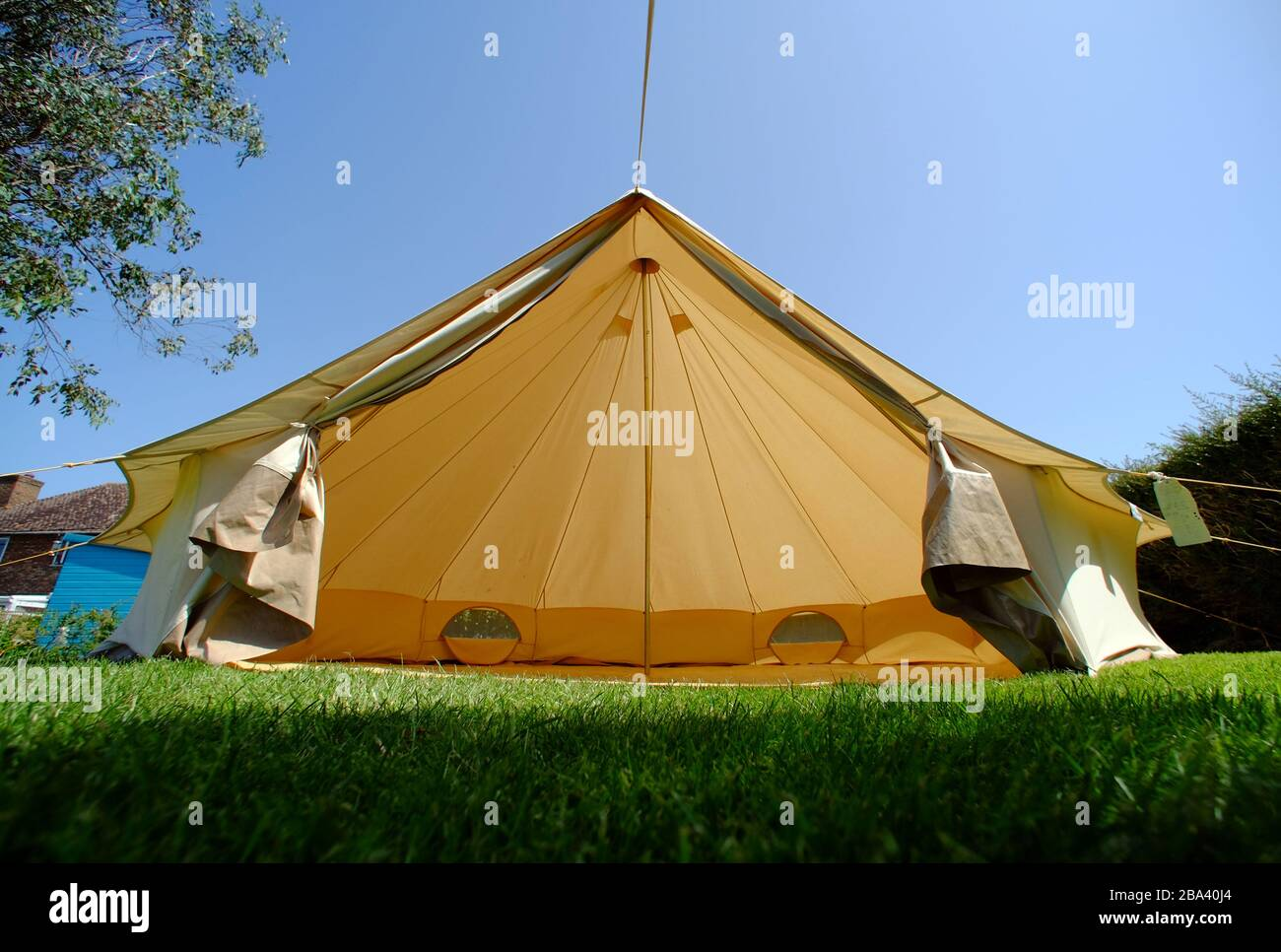 Bell tent in a garden on a summer day. Stock Photo