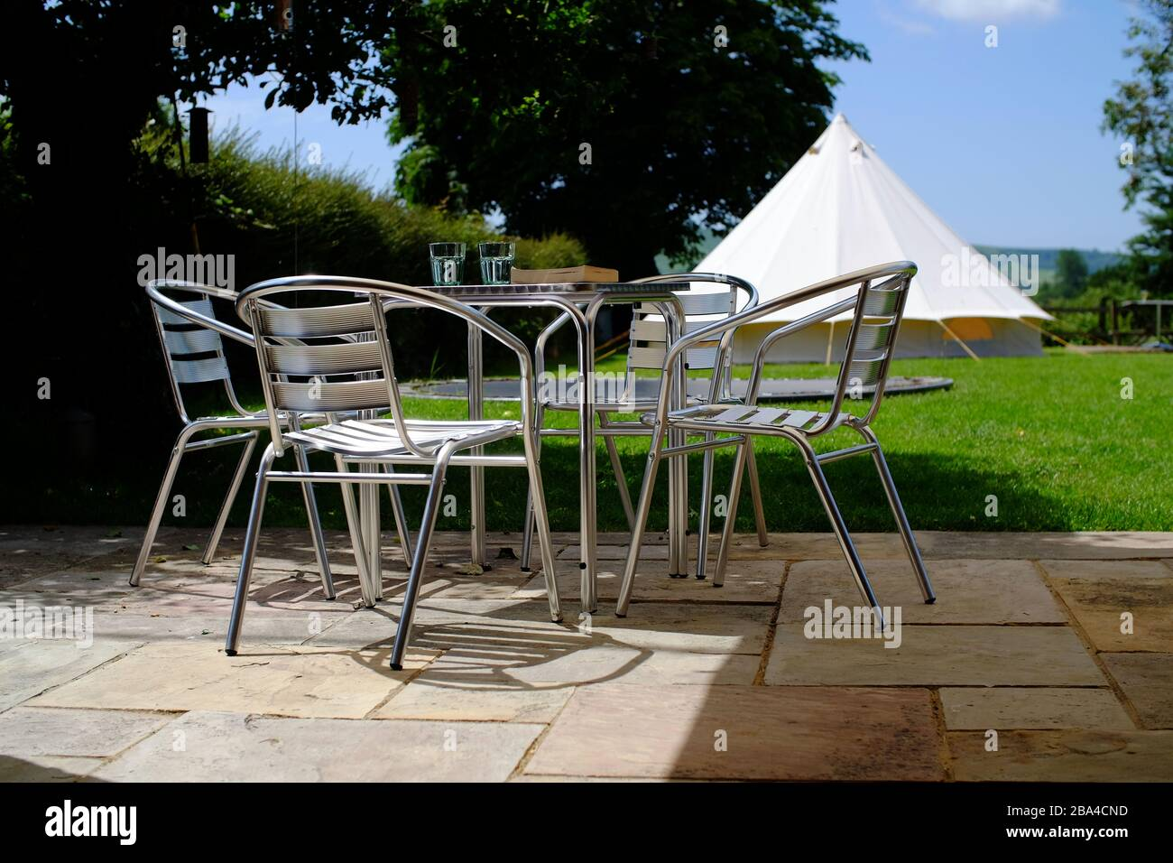 Glamping at home for a stay-cation. Garden camping in a bell tent for summer. UK Stock Photo
