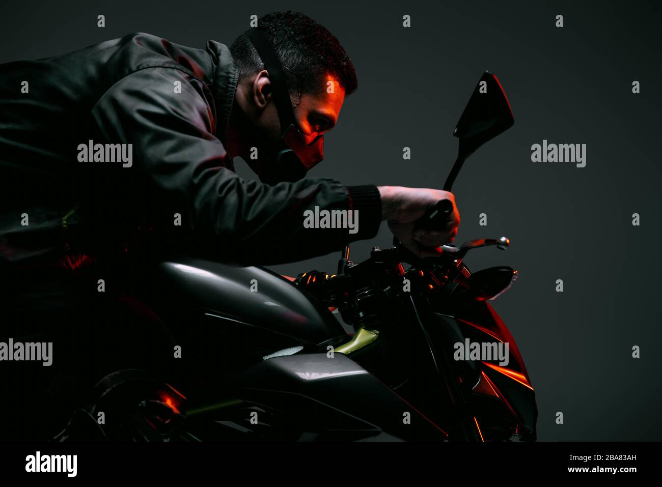 Profile Of Mixed Race Cyberpunk Player In Mask Riding Motorcycle On Grey Stock Photo Alamy