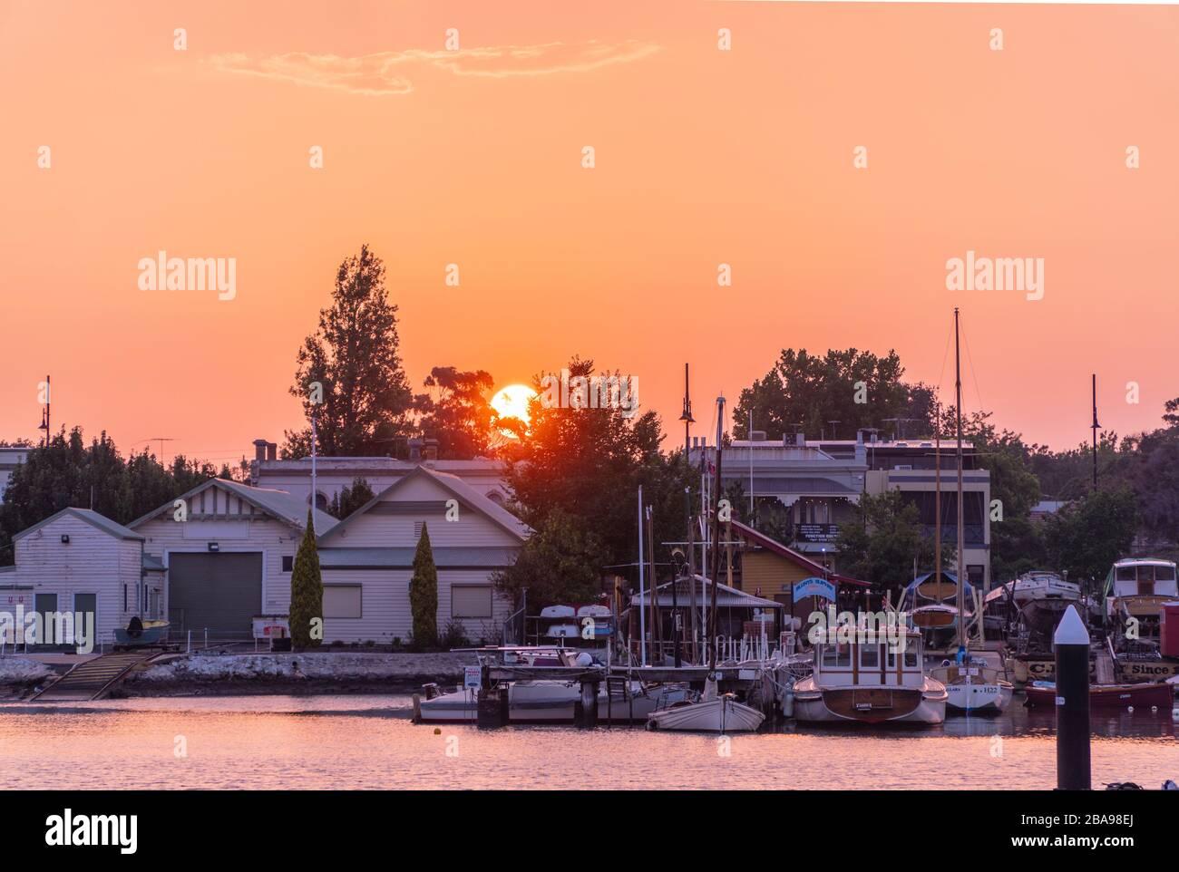 Sunset at riverside house Stock Photo