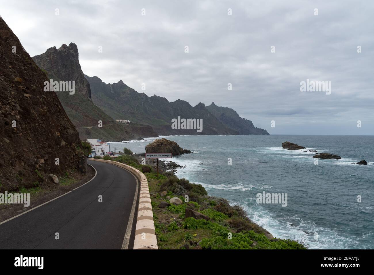 Roque de Las Bodegas, Tenerife,  -Jaunary 11, 2020: View to waves and cliff near Roque de Las Bodegas beach in the area of Taganana from coastline roa Stock Photo