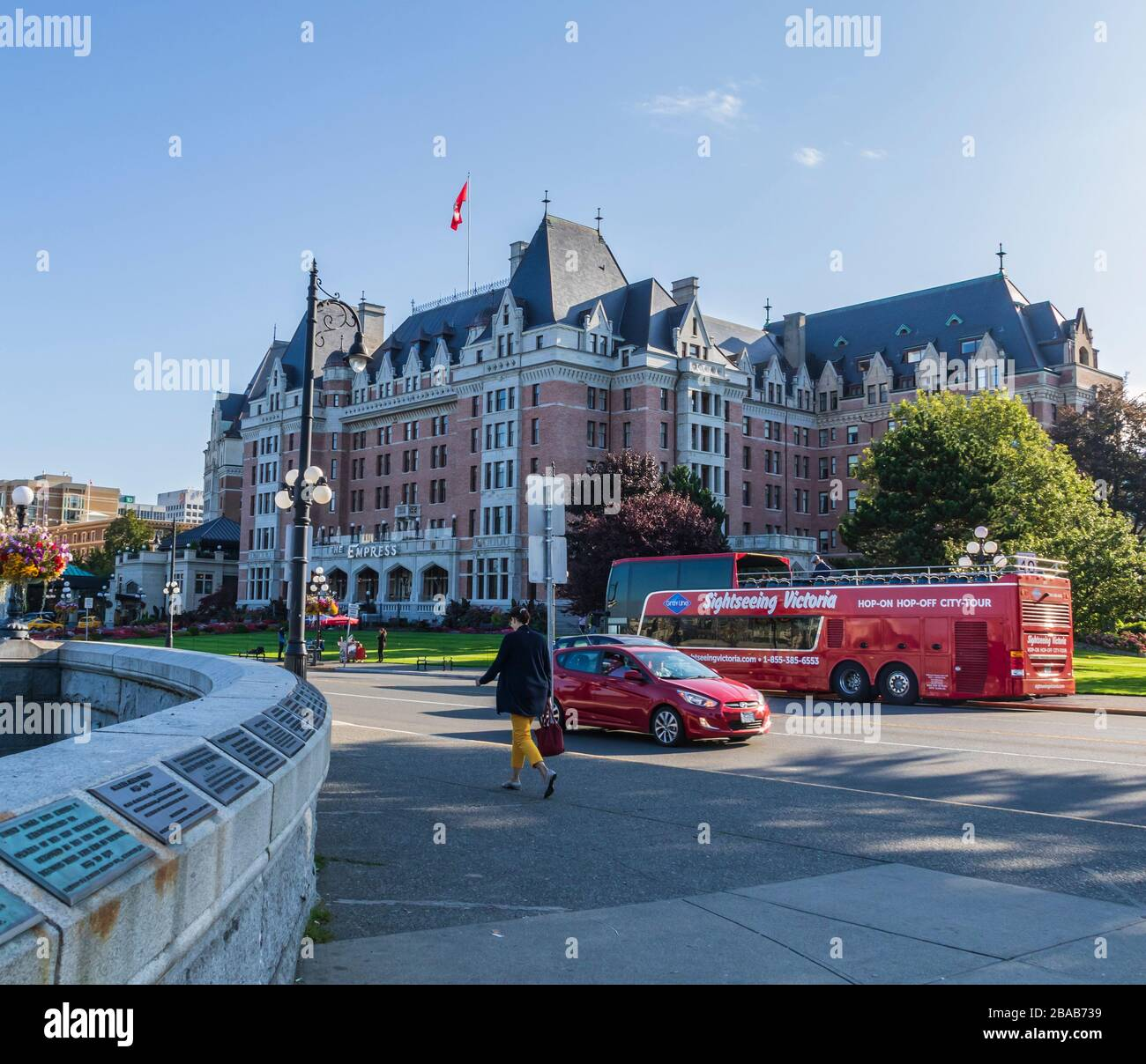 Hop-on Hop-off tour bus in front of Fairmont Empress Hotel at the harbor in Victoria, British Columbia, Canada. Stock Photo