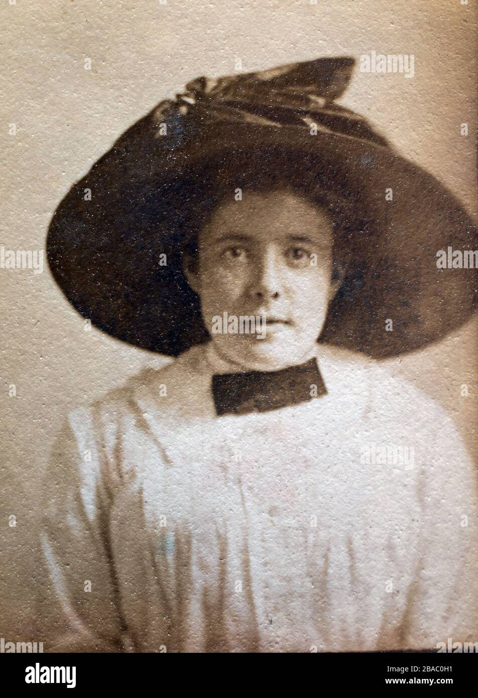 Archive portrait circa 1910 of a young Edwardian woman - printed on textured paper. Stock Photo
