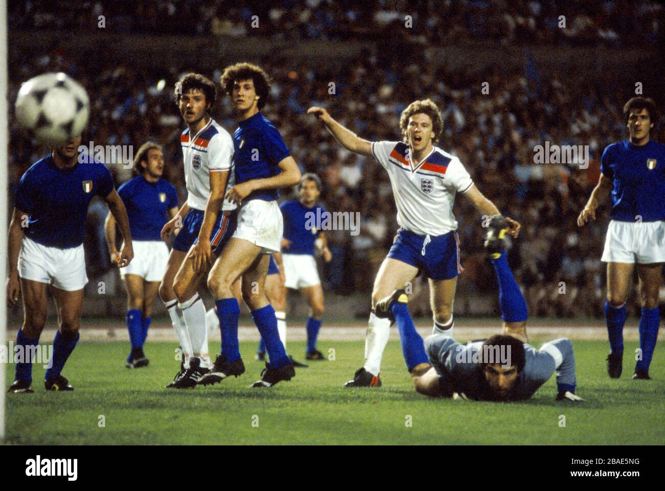 Italy Goalkeeper Dino Zoff (on Floor) makes a great save as England's Garry Birtles and Tony             Woodcock look on Stock Photo