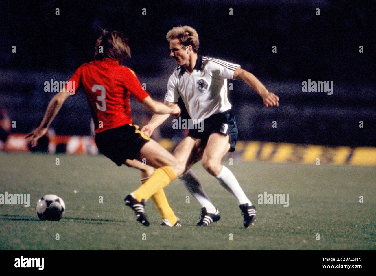 West Germany's Karl-Heinz Rummenigge (r) takes on Belgium's Luc Millecamps (l) Stock Photo