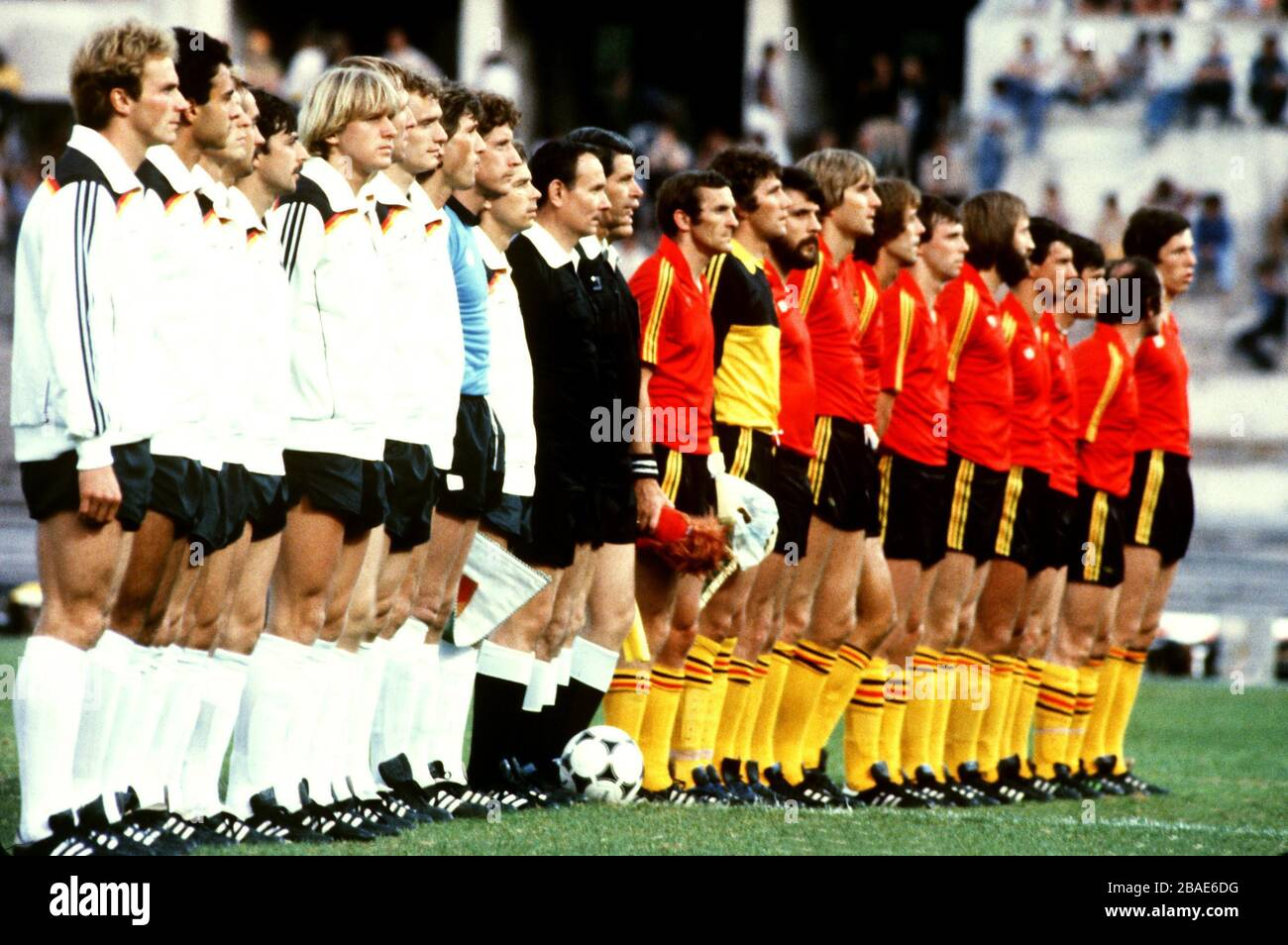 The two teams line up for the national anthems before the match Stock Photo