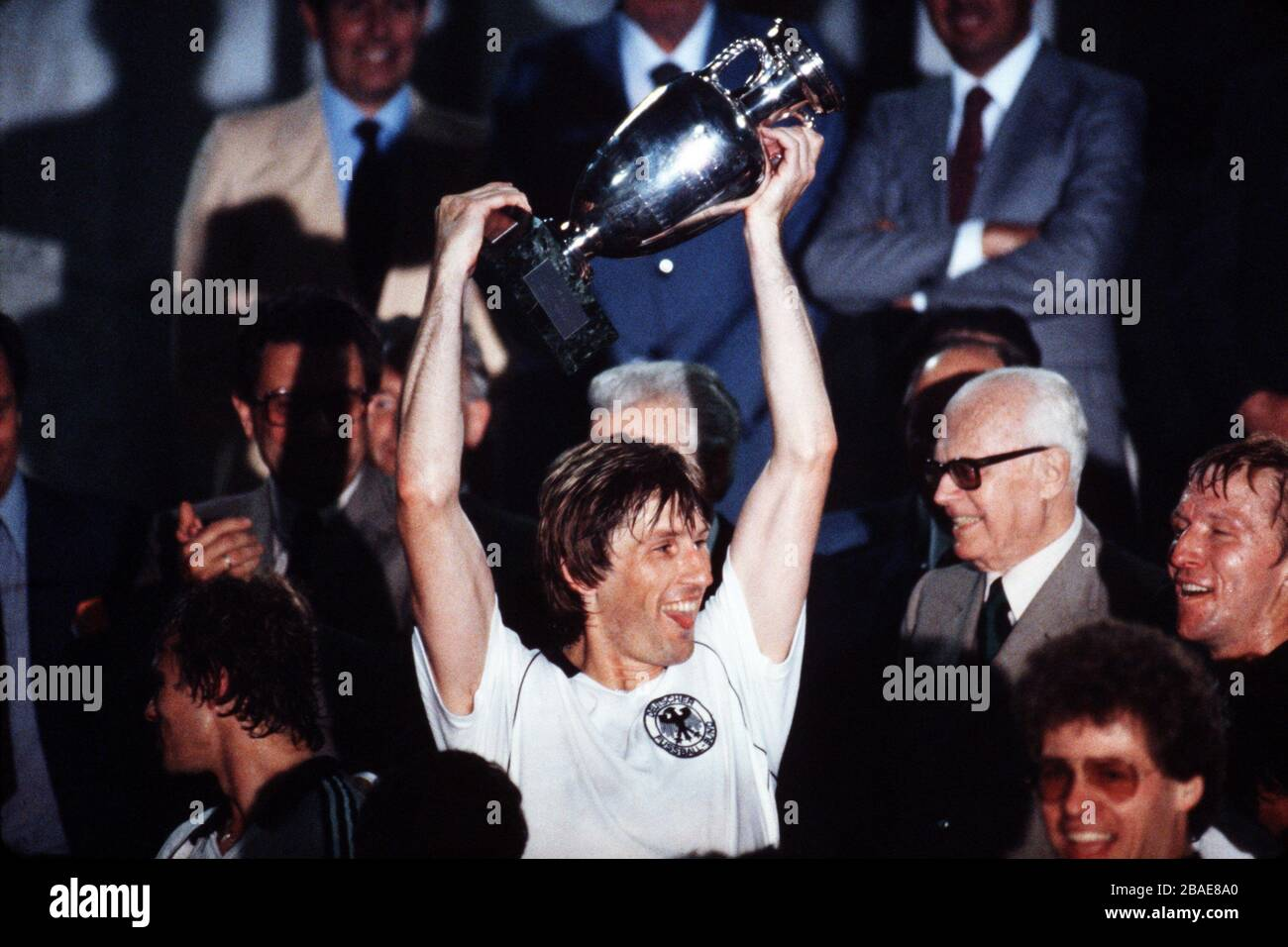 West Germany's Manny Kaltz celebrates with the trophy after his team's 2-1 win Stock Photo