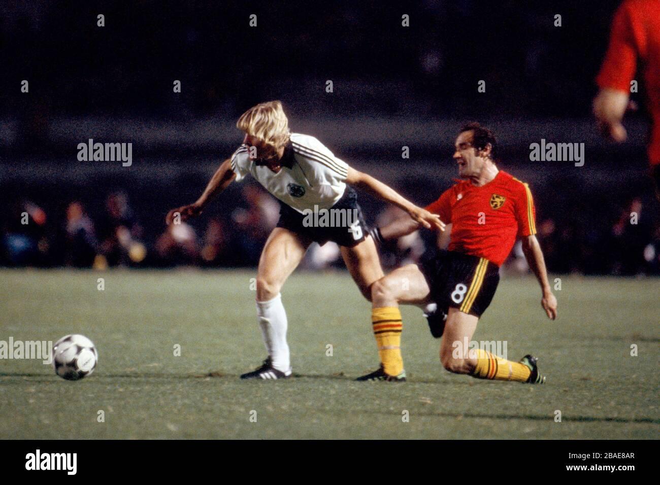 West Germany's Bernd Schuster (l) holds off Belgium's Wilfried van Moer (r) Stock Photo