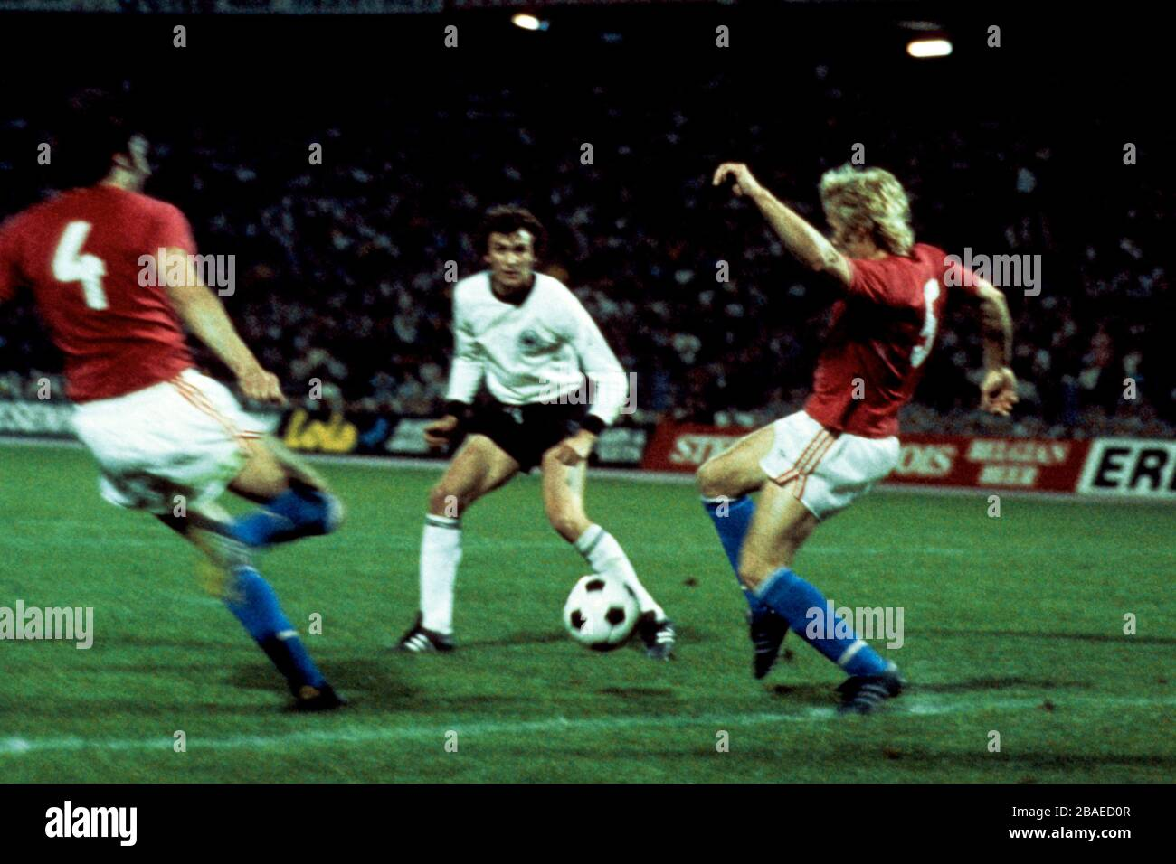 Czechoslovakia 's Anton Ondrus (l) and Jan Capkovic (r) with West Germany's Dieter Muller (c) Stock Photo