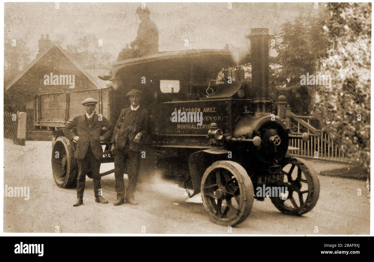 A vintage photograph of a Foden Steam Wagon c1920 in the service of the North Yorkshire County surveyor (UK), together with three unidentified staff members. Foden Trucks was a British truck and bus manufacturing company originating in in Elworth near Sandbach in 1856. Stock Photo