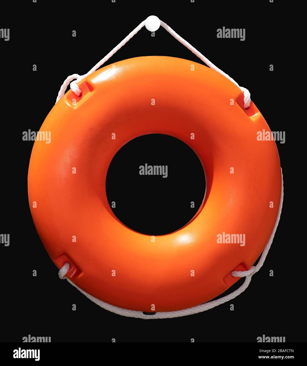Orange lifebuoy isolated, attached on the wall. Maritime lifeguard equipment. Stock Photo
