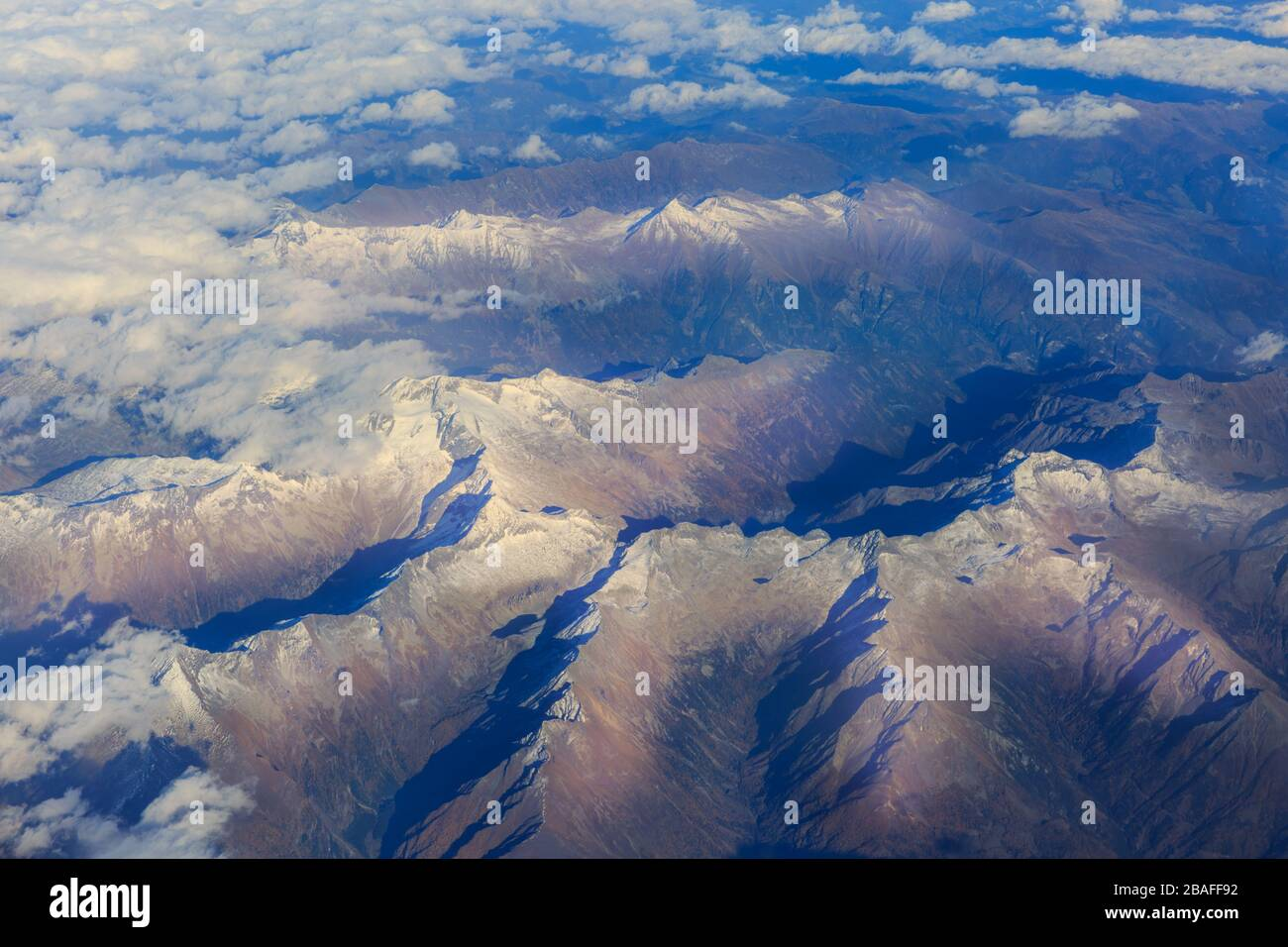 The Alps from above, Italian Alps and Dolomites aerial view, mountains with clear skies and sunshine, Europe Stock Photo