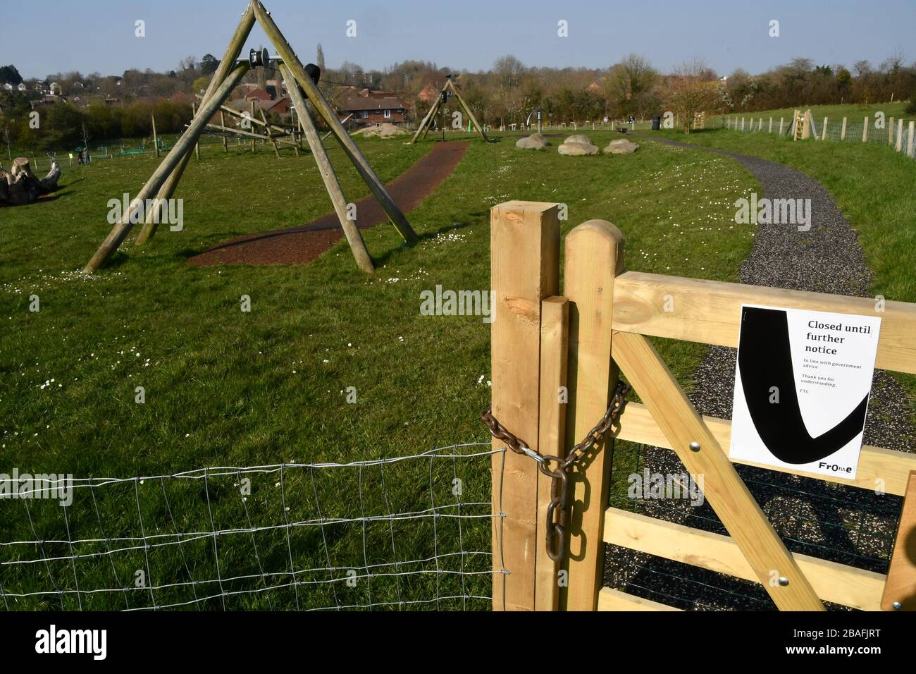 Childrens Play area closed, padlocked and empty due to the corona virus epidemic. 26th March 2020. Frome, Somerset,UK Stock Photo