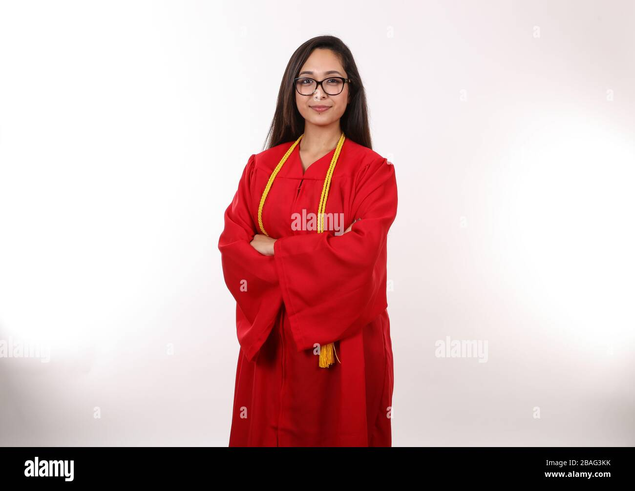 A recent female graduate poses for a portrait. Stock Photo
