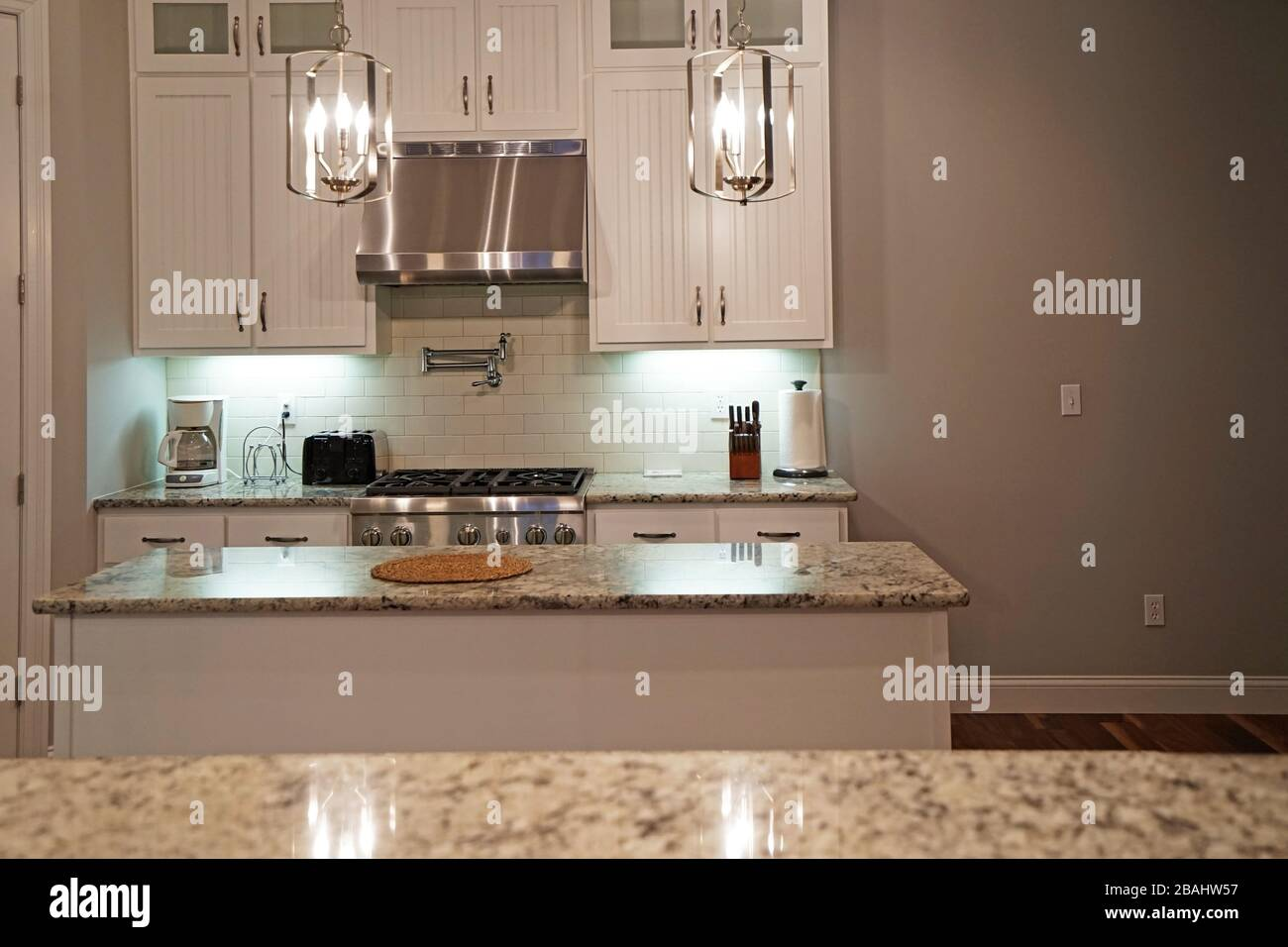 Interior Design And Kitchen Architecture Decorated With White Wooden Furniture Marbled Materials And Built In Appliances Stock Photo Alamy