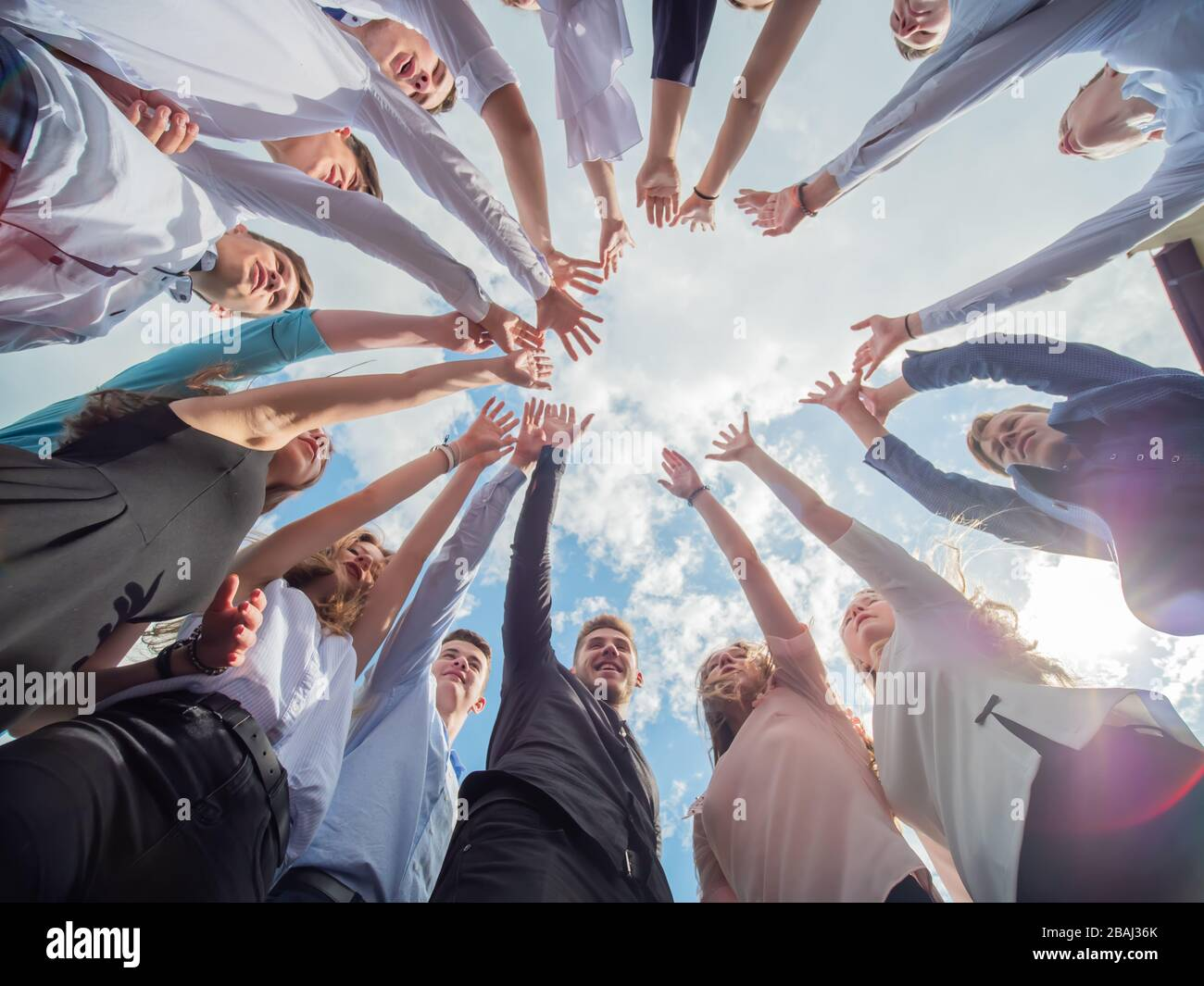 Friendly friends spread their hands. The concept of strong friendship. Stock Photo