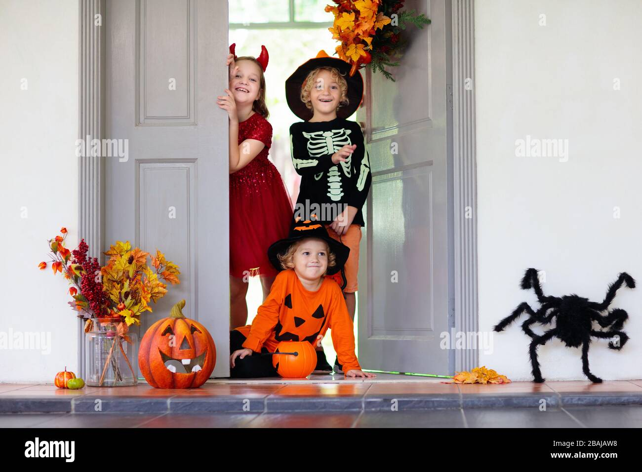 Kids trick or treat on Halloween night Dressed up children