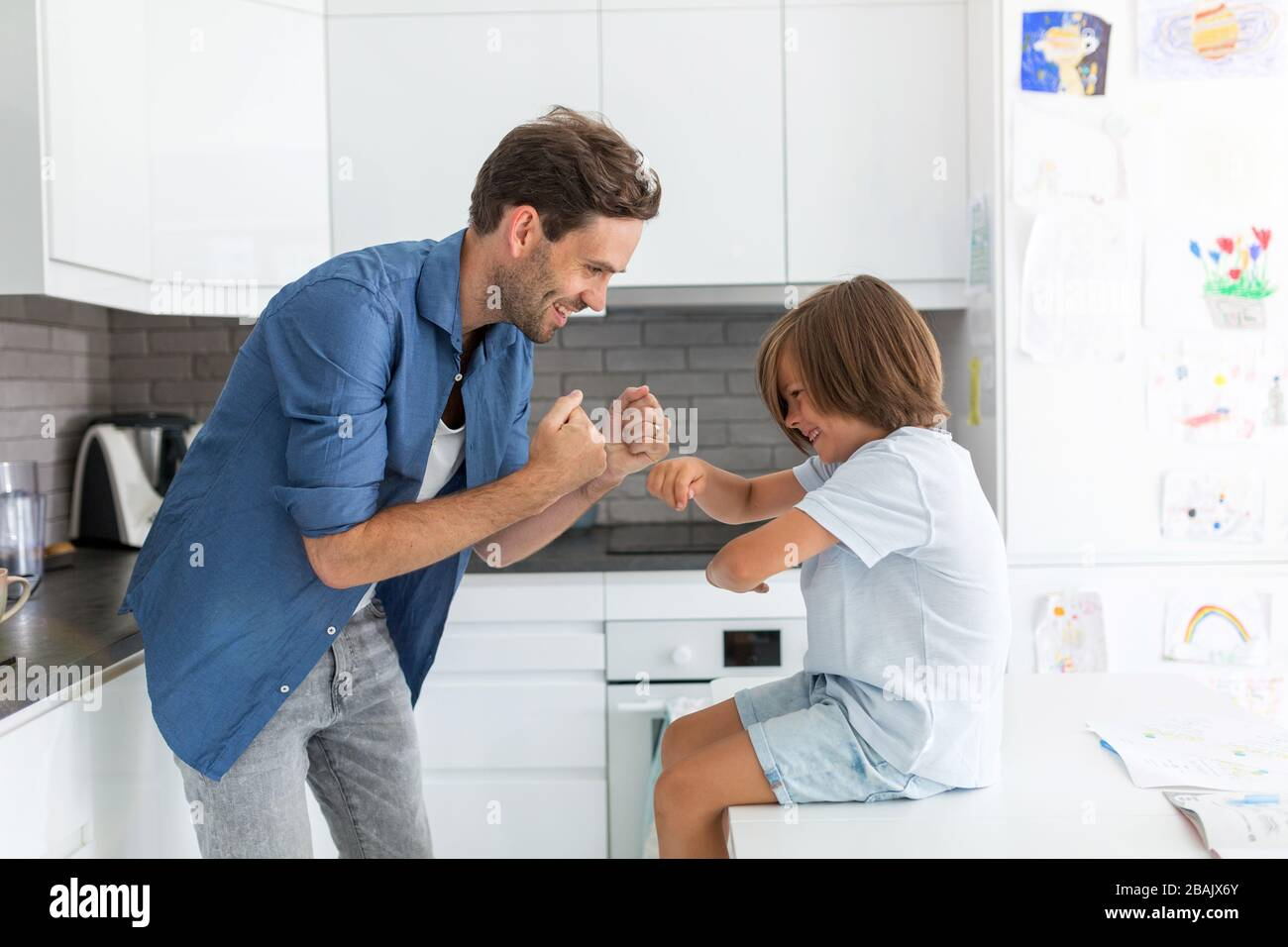 Father and son in the kitchen Stock Photo