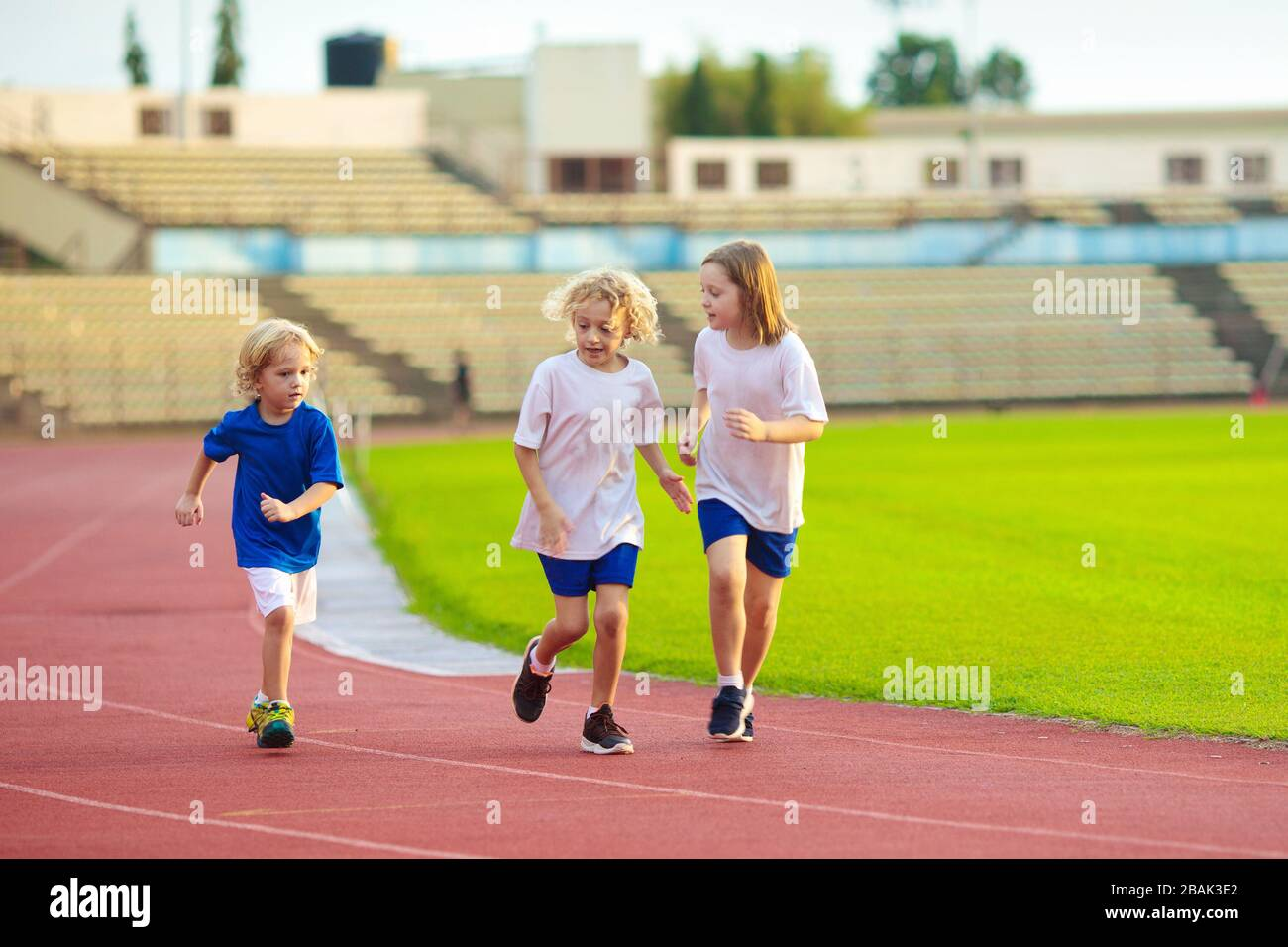 little girl athletics two girls running on athletic race track-4637 | Meashots