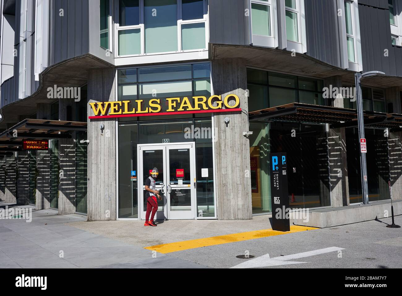 A man walks past a branch of Wells Fargo Bank in the SoMa District of San Francisco, California, on Sunday, Feb 9, 2020. Stock Photo
