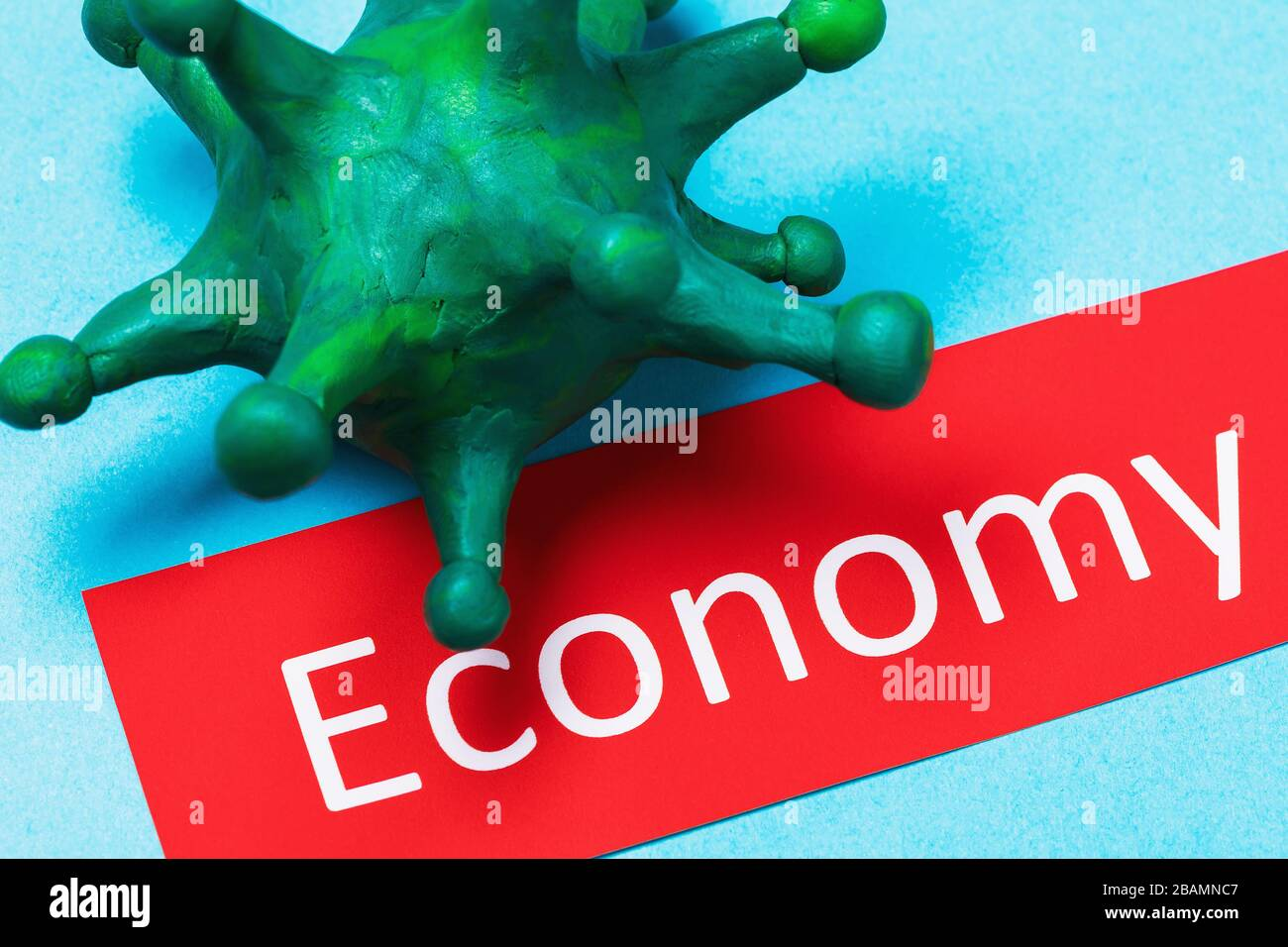 Tag with text and coronavirus. The concept of the impact of the COVID-19 pandemic on the global economy Stock Photo