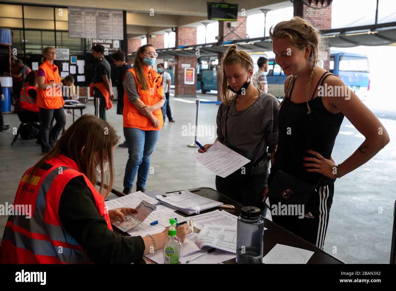 Kathmandu Nepal 27th Mar 2020 A Staff From German Embassy Checks Passenger S Passports For Their Chartered
