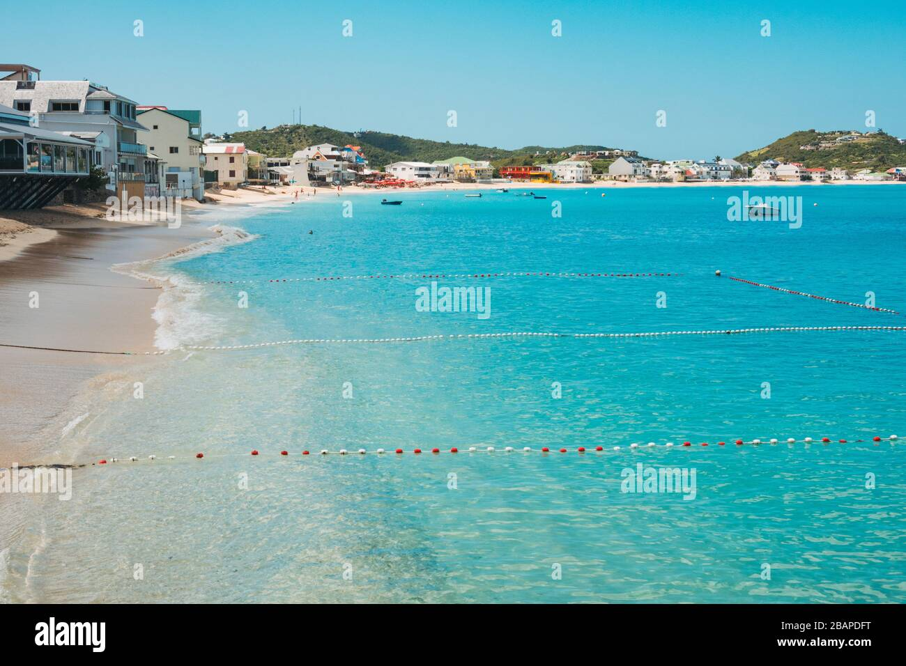 Buoyed off swimming areas in the blue waters of Grand Case Beach, Saint Martin (French side) Stock Photo