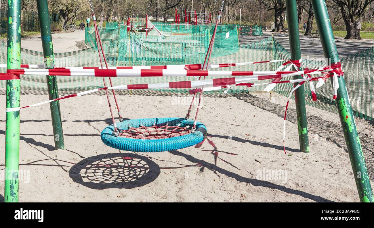 The image was taken in Leipzig, eastern germany. It shows a closed playground during the time of corona quarantene. Children are not allowed to play. Stock Photo