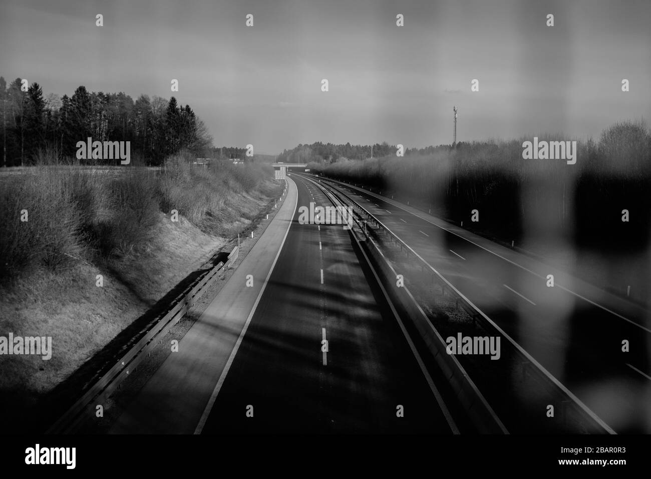 Kranj, Slovenia, March 20, 2020: An empty highway during the coronavirus outbreak nationwide lockdown is seen from a fenced overpass. Stock Photo