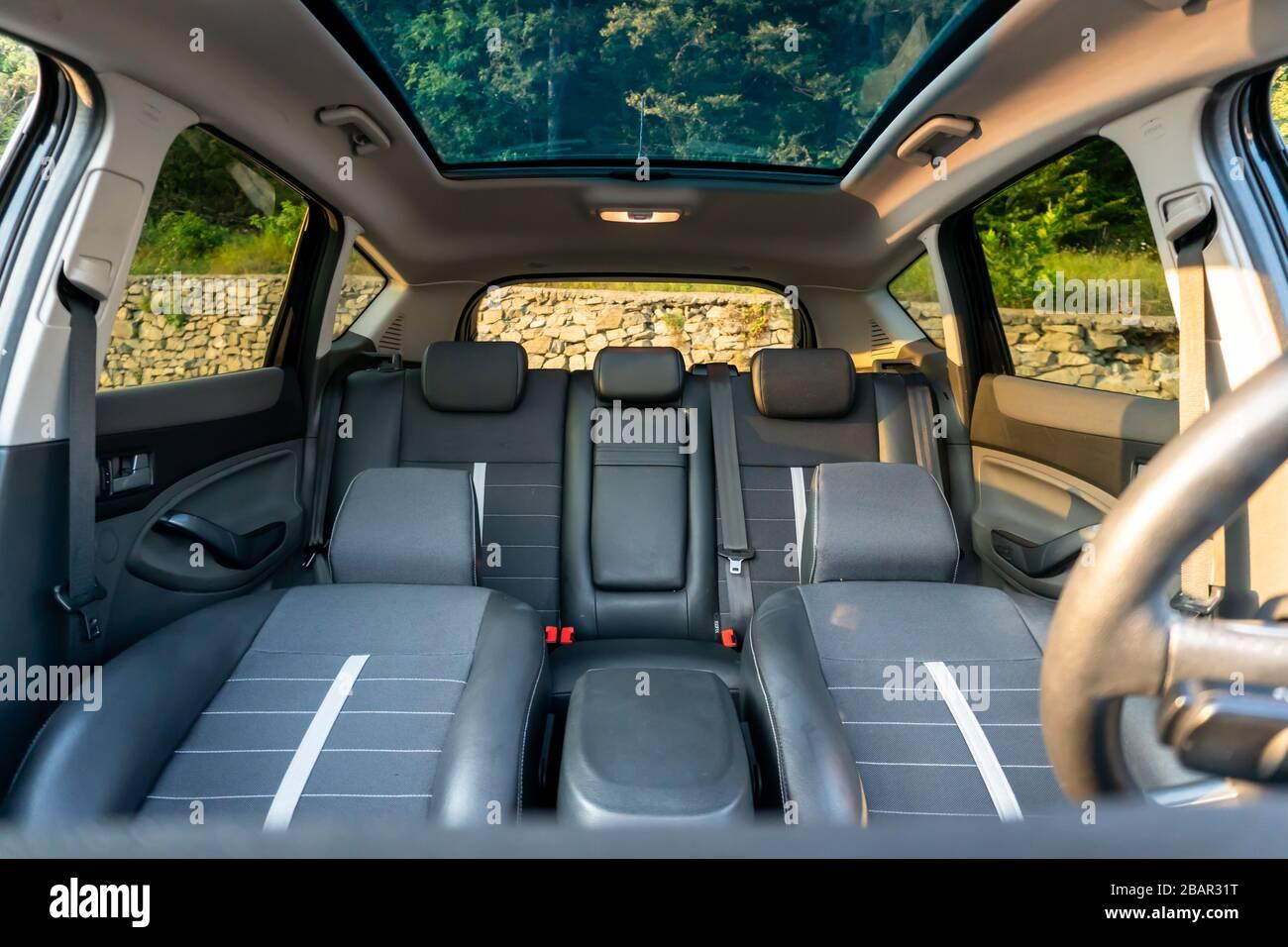 Inside detailed photo of wonderful SUV with panoramic glazed dach/sunroof Stock Photo