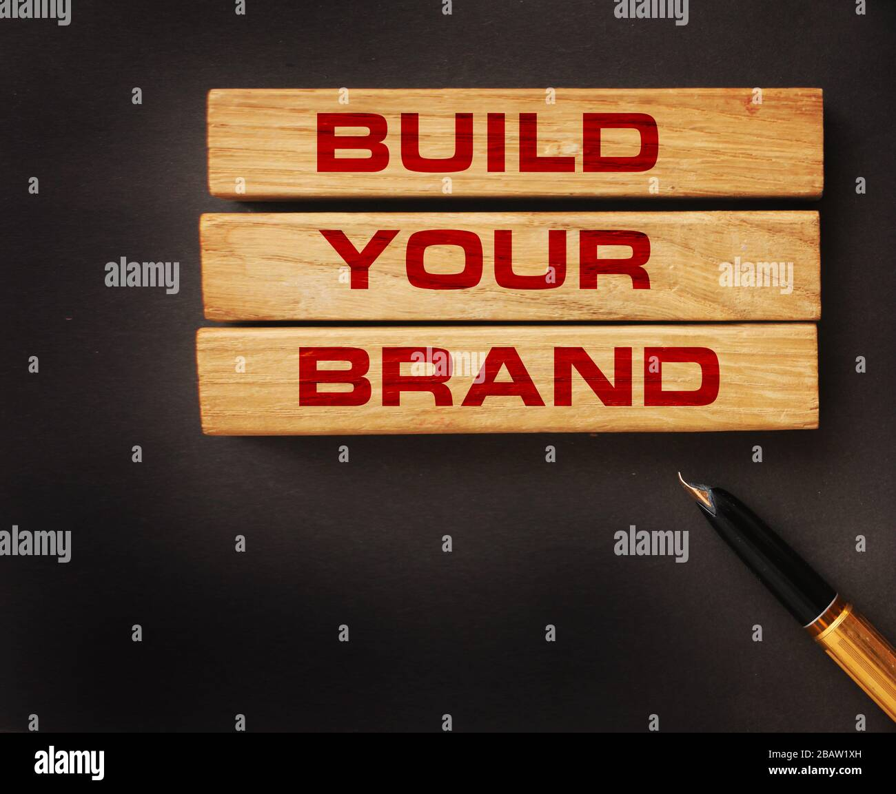 Build your Brand written on wooden blocks with vintage styled background. Branding rebranding marketing concept Stock Photo