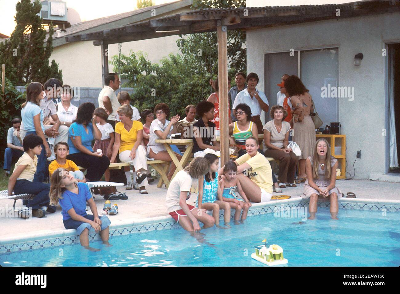 English Title Family Near A Pool Description A Large Group Of Adults And Children Sitting Around A Swimming Pool They Are Members Of A National Group Called The Candlelighters Which Gives Emotional