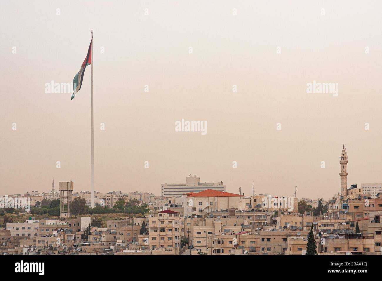 The Raghadan Flagpole, one of the tallest free-standing flagpoles in the world, stand on top of a hill in Amman, Jordan. Stock Photo