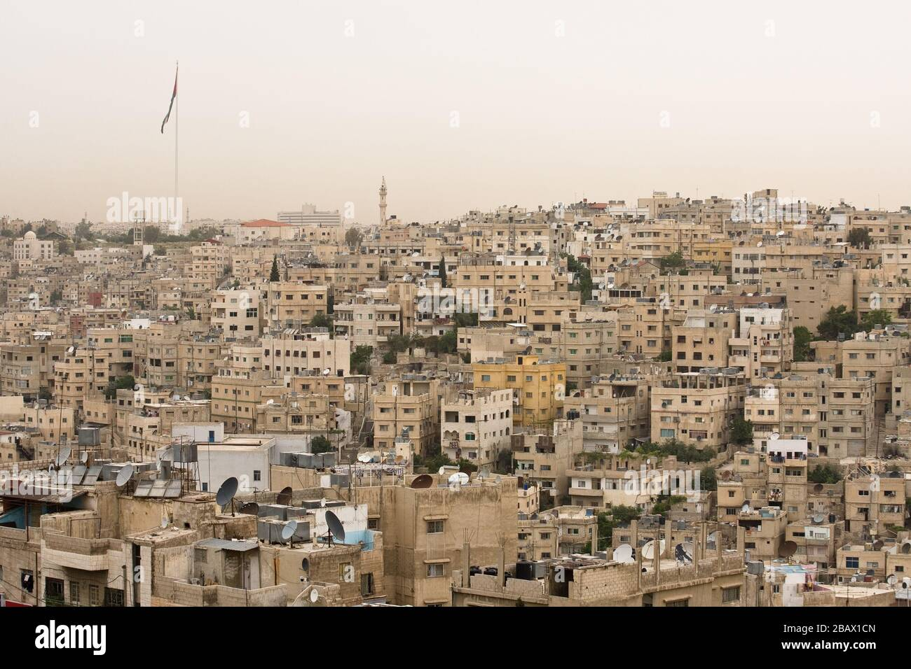 The old city of Amman, Jordan, with tha Raghadan Flagpole, one of the tallest free-standing flagpoles in the world, in the background. Stock Photo
