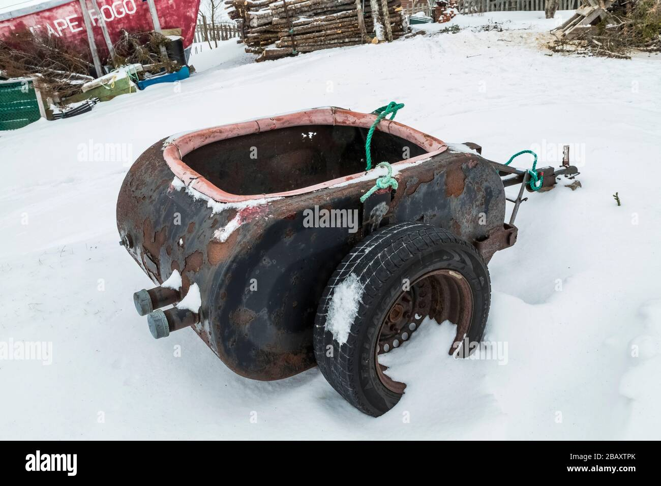 Cliver oil tank trailer for ATV or Ski-Doo at the home of Desmond Adams in Joe Batt's Arm on Fogo Island, Newfoundland, Canada [No property release; a Stock Photo