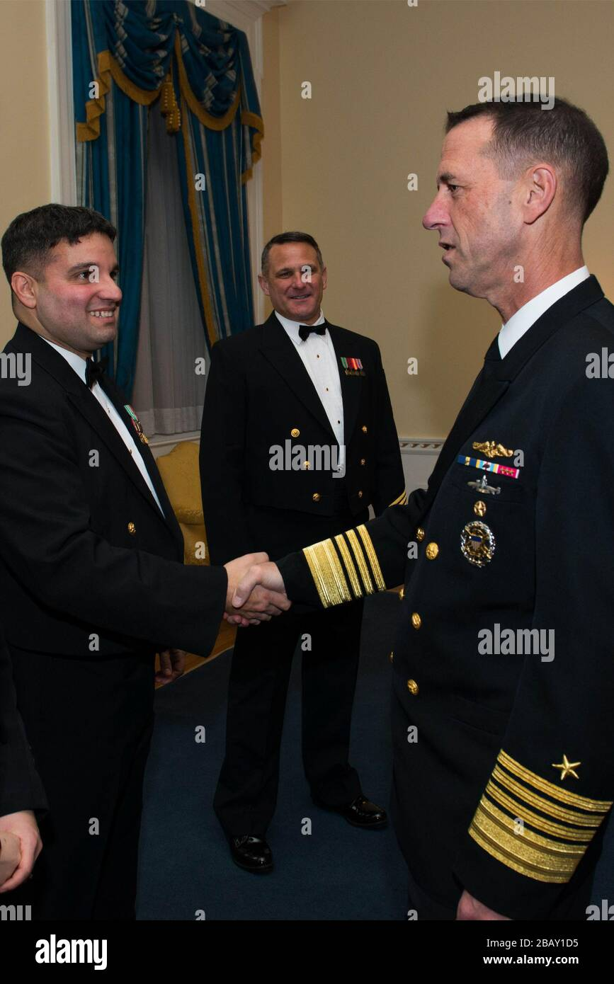 """""""161217-N-VV903-012 WASHINGTON (Dec. 17, 2016) Chief Petty Officer Michael Belinkie, left, meets the Chief of Naval Operations Adm. John Richardson, right, backstage after the Saturday evening Navy Band Holiday Concert held at DAR Constitiution Hall in Washington, D.C. The Navy Band hosted thousands of people from the Washington area as well as hundreds of senior Navy and government officials during its three annual holiday concerts. (U.S. Navy photo by Petty Officer 1st Class David Aspinwall/Released); 17 December 2016, 20:31; Navy Band Holiday Concert; United States Navy Band from Washington Stock Photo"""