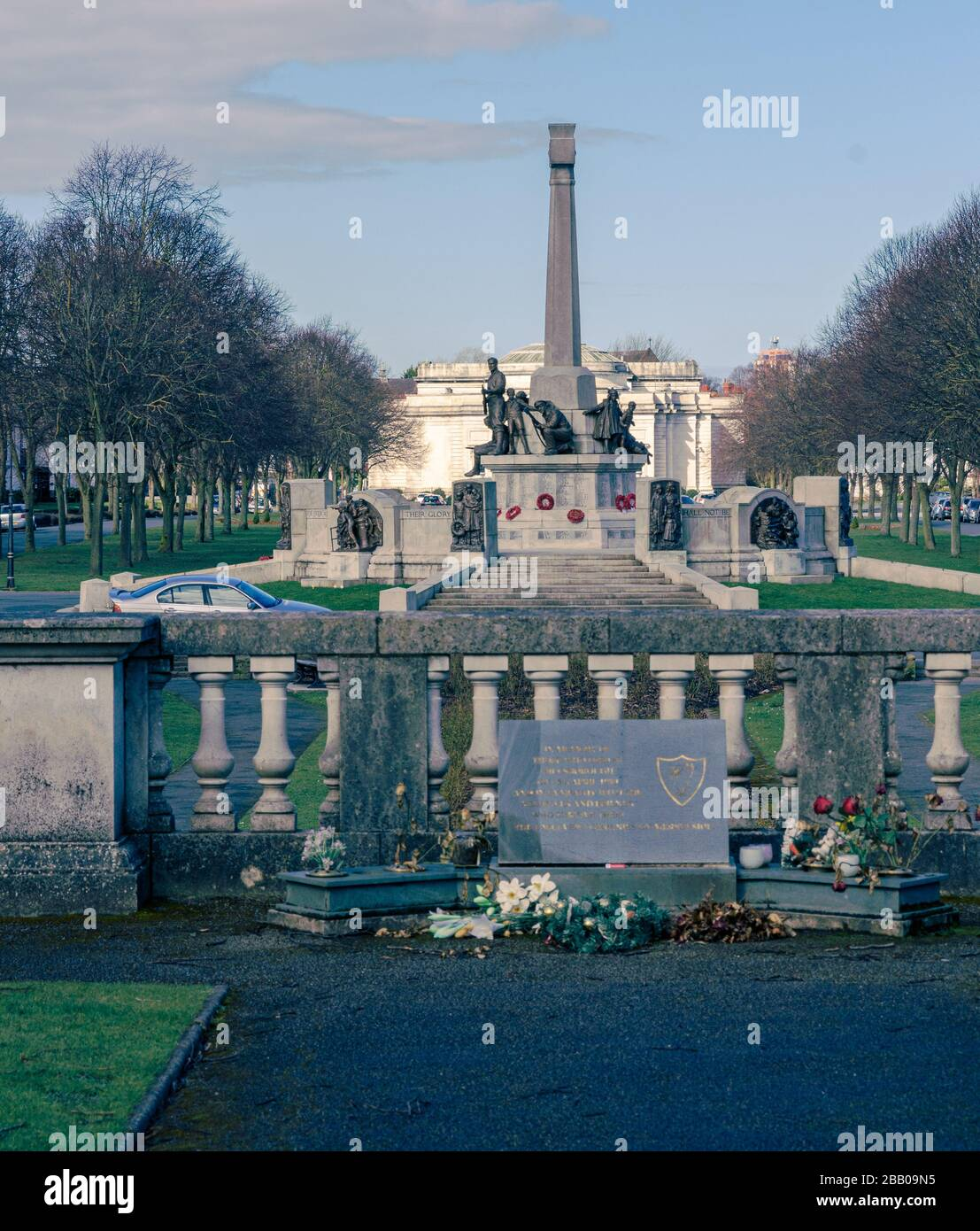 Port Sunlight Hillsborough disaster Memorial Garden to 96 football supporters, with village war memorial and Lady Lever Art Gallery in the background. Stock Photo