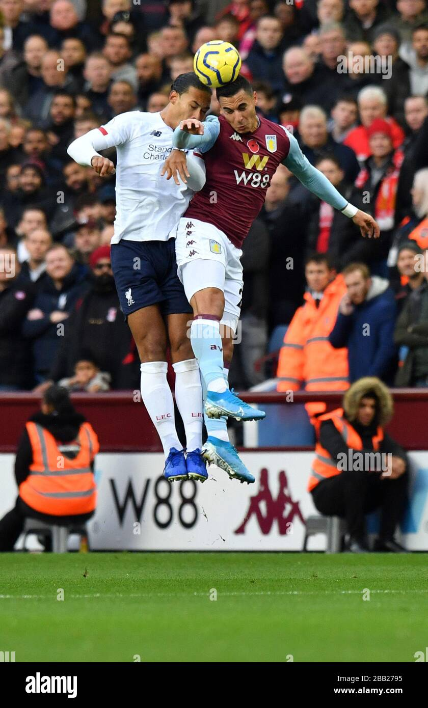 Aston Villa S Frederic Guilbert And Liverpool S Virgil Van Dijk Compete For A Header Stock Photo Alamy