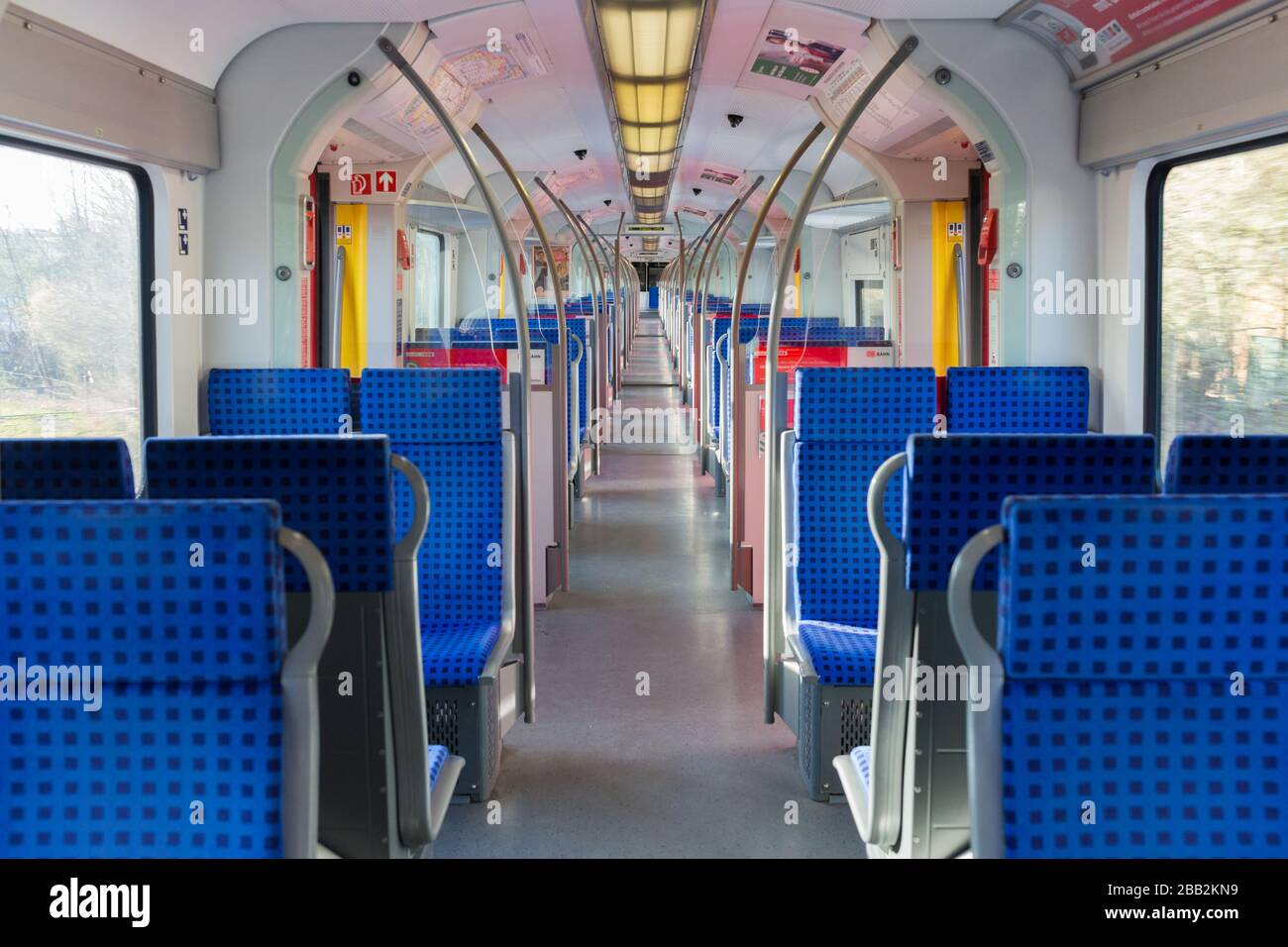 Interior view of an empty S-Bahn (public transport train). The number of people which use public transport significantly decreased due to Coronavirus. Stock Photo