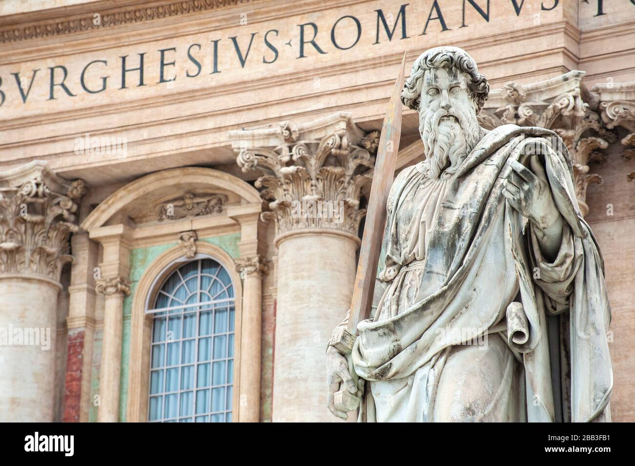 Statue of St. Paul standing in front of St. Peter's Basilica, St. Peter's Square, Vatican City, Rome Stock Photo