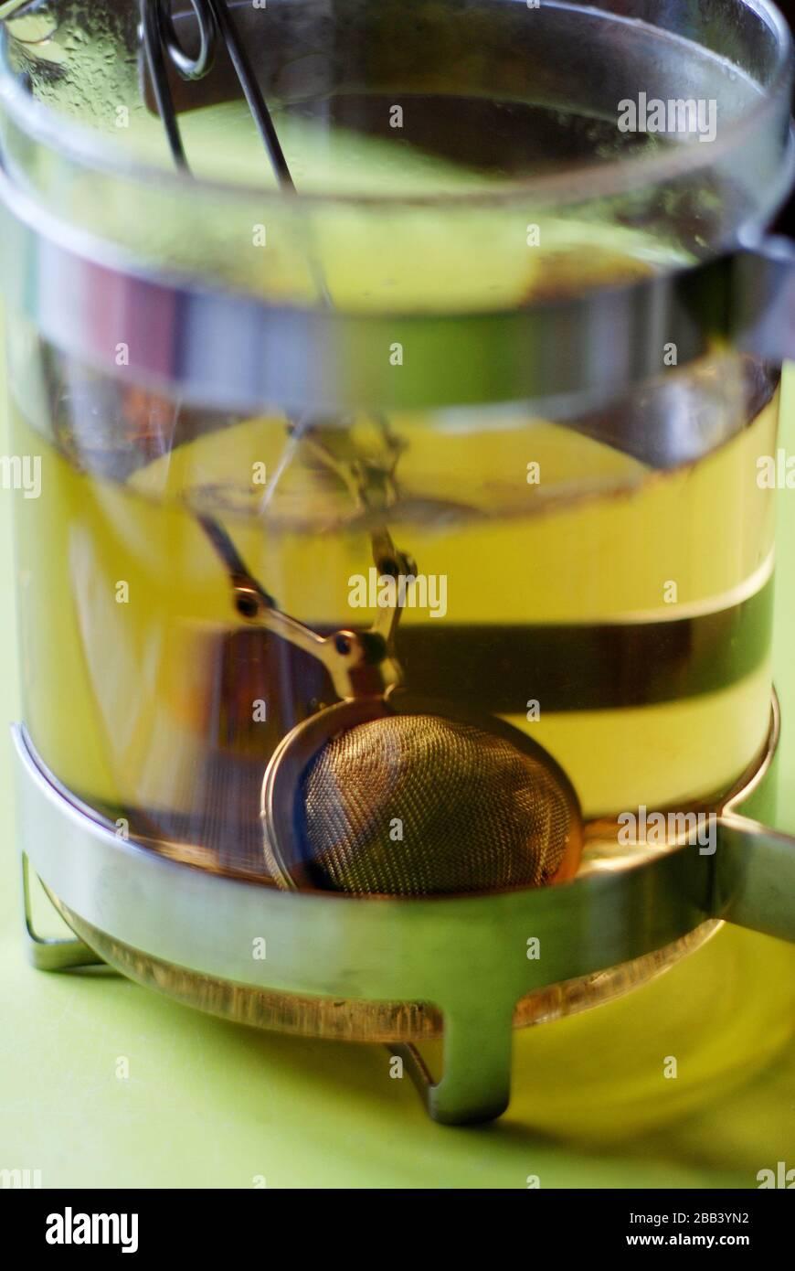 Tea sieve inside a glas to prepare a tea Stock Photo
