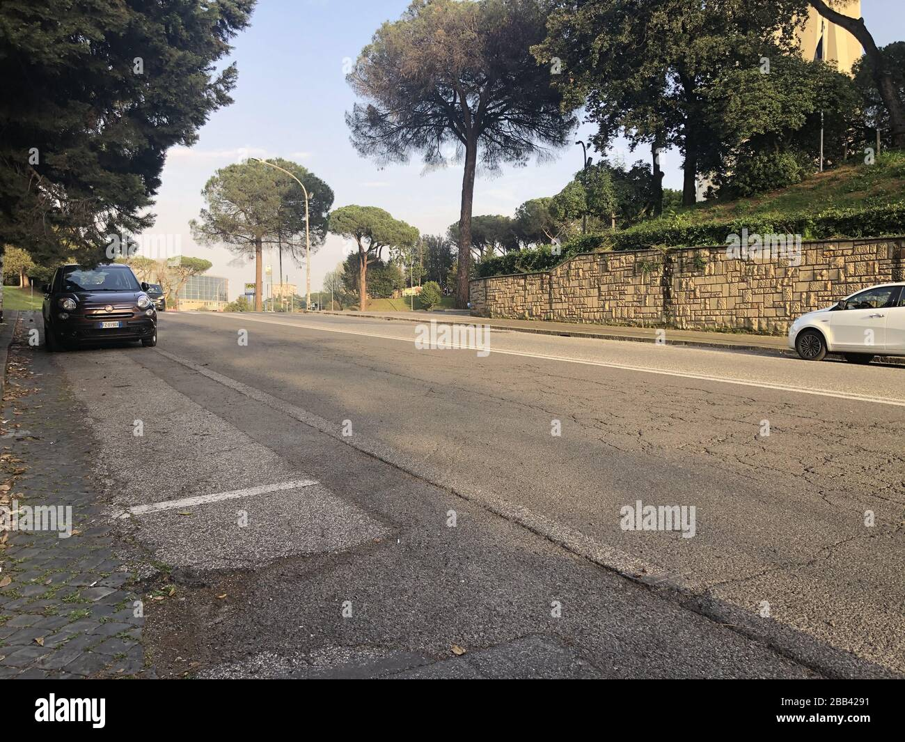 ROME, ITALY - MARCH 29, 2020: A view of a street during quarantine amid the COVID-19 pandemic. On March 8, 2020, the Italian government ordered to close all the museums, archeological sites and cultural institutions; starting from March 12, the country is on full lockdown with all shops, bars and restaurants closed, except for grocery stores and pharmacies. Walking outside is prohibited with certain exceptions. Vera Shcherbakova/TASS Stock Photo