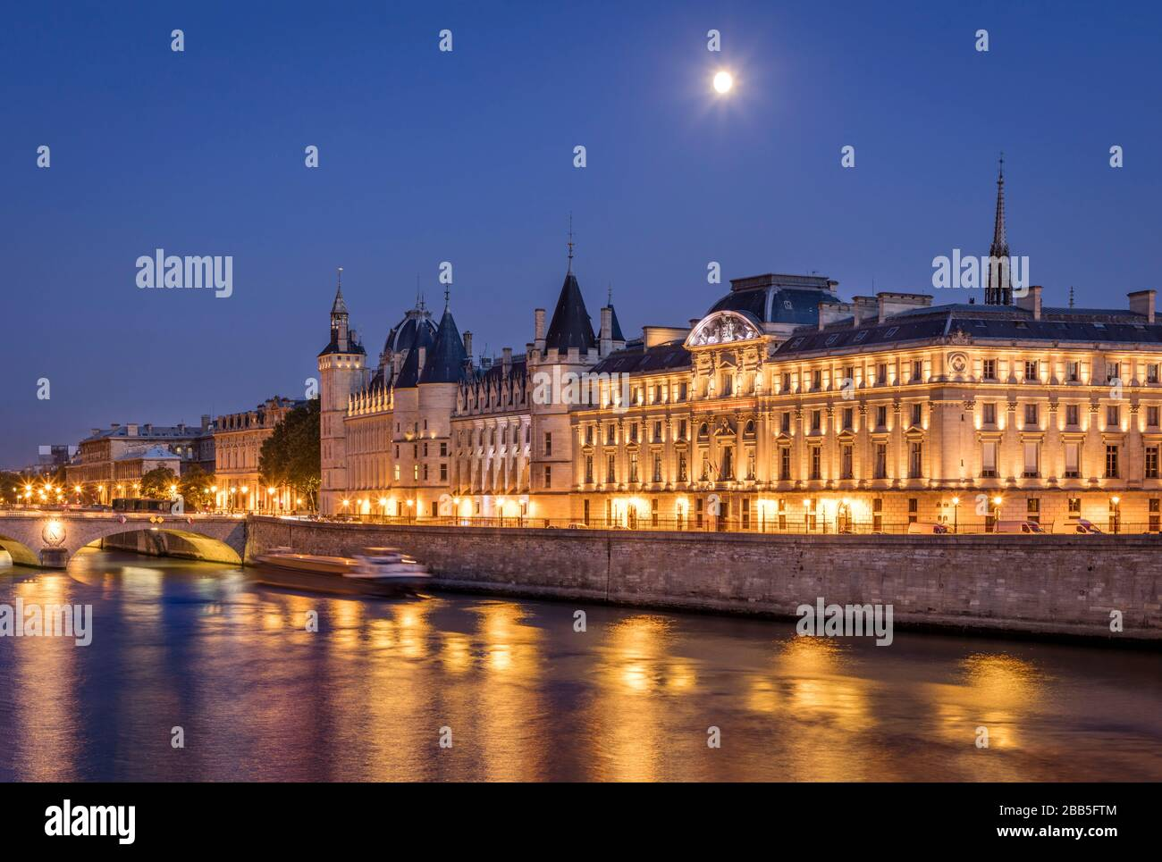 River Seine and the Conciergerie at twilight, Paris, France Stock Photo