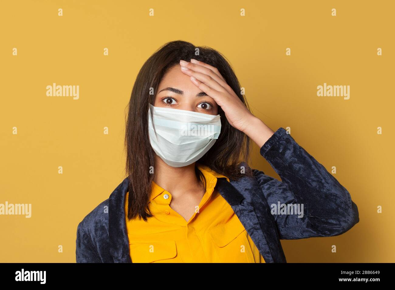 Panicking sick black woman on yellow. Epidemic and virus protection concept Stock Photo