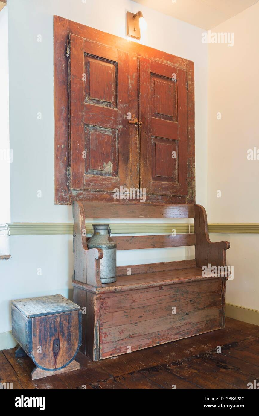 Antique Wooden Sitting And Storage Bench In Corner Of Dining Room With Stained Pinewood Floorboards Inside