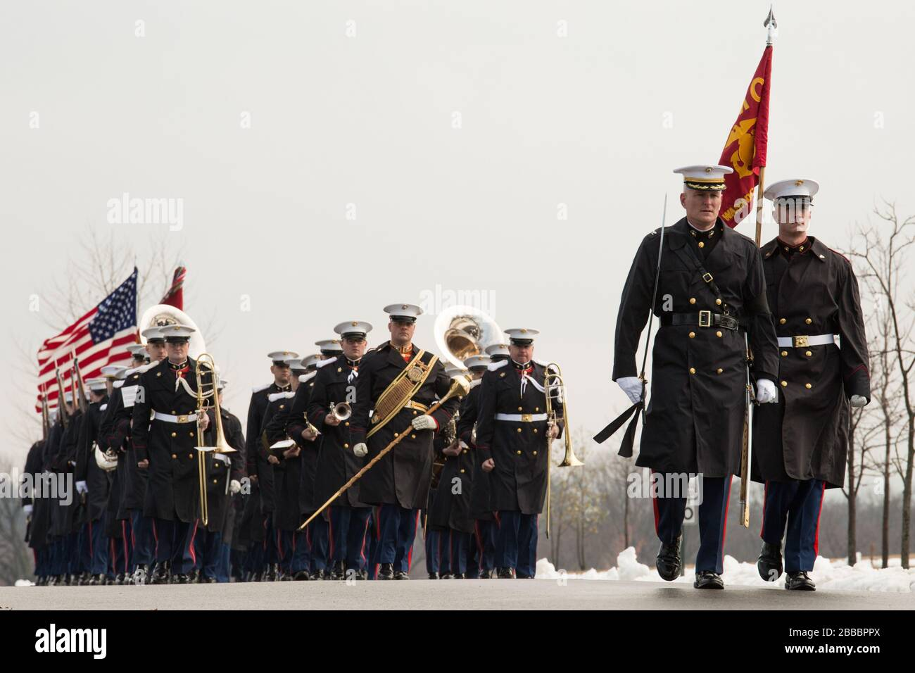 """""""Col. Christian G. Cabaniss, commanding officer of Marine Barracks Washington, D.C., The President's Own U.S. Marine Band and Barracks' ceremonial marchers march toward the gravesite of retired Col. Charles H. Waterhouse and his wife Barbara at Arlington National Cemetery, Feb. 19, 2014. Waterhouse and his wife were laid to rest 69 years to the day after he landed on Iwo Jima during World War II. Waterhouse originally left the Corps in 1946, but accepted a special commission as a major in the reserves in 1972 as the Marine Corps' first and only artist-in-residence. He painted more than 160 wor Stock Photo"""