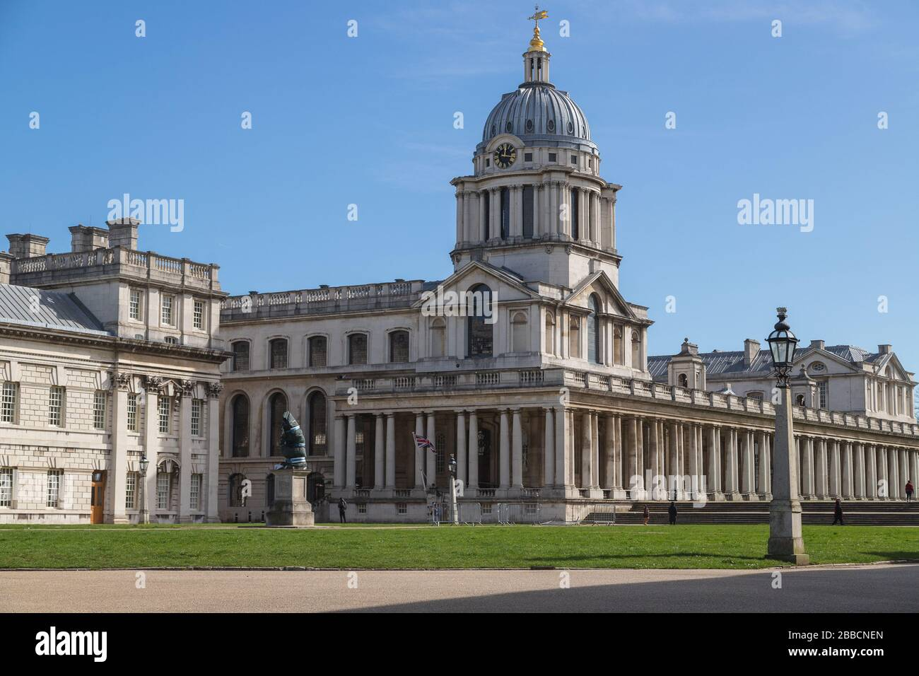 LONDON, UK - 21ST MARCH 2020: Architecture on the University of Greenwich in London. A few people can be seen. Stock Photo