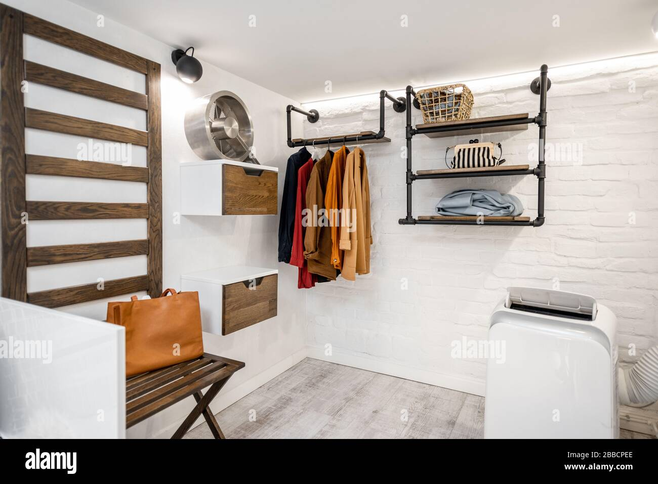 Modern Wardrobe Or Small Clothes Store Interior With Garment Stock Photo Alamy
