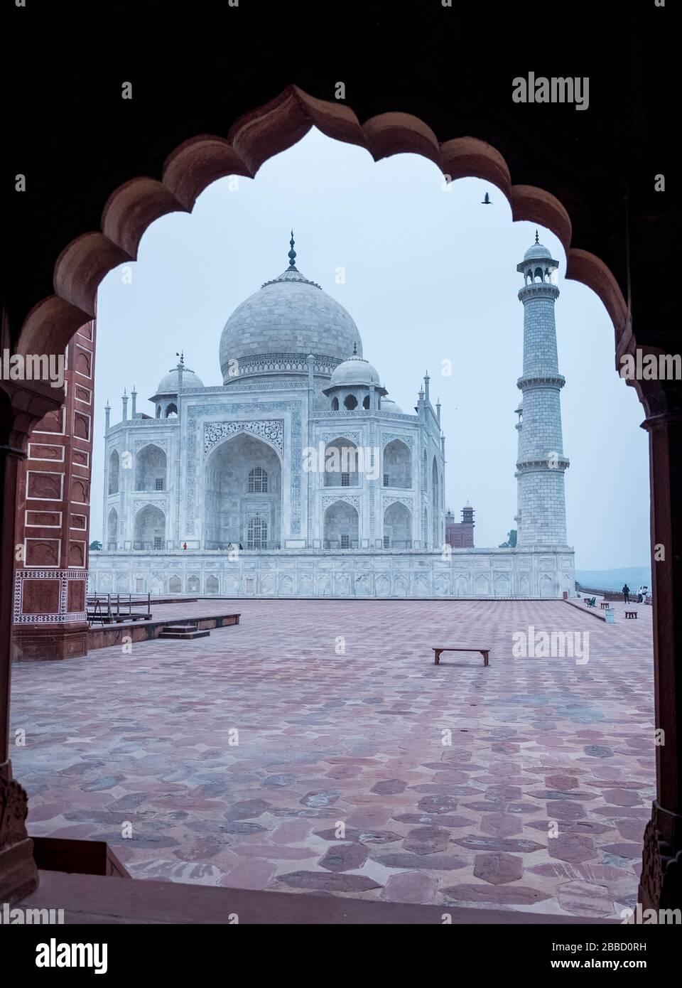 Taj Mahal though an arched gate Stock Photo