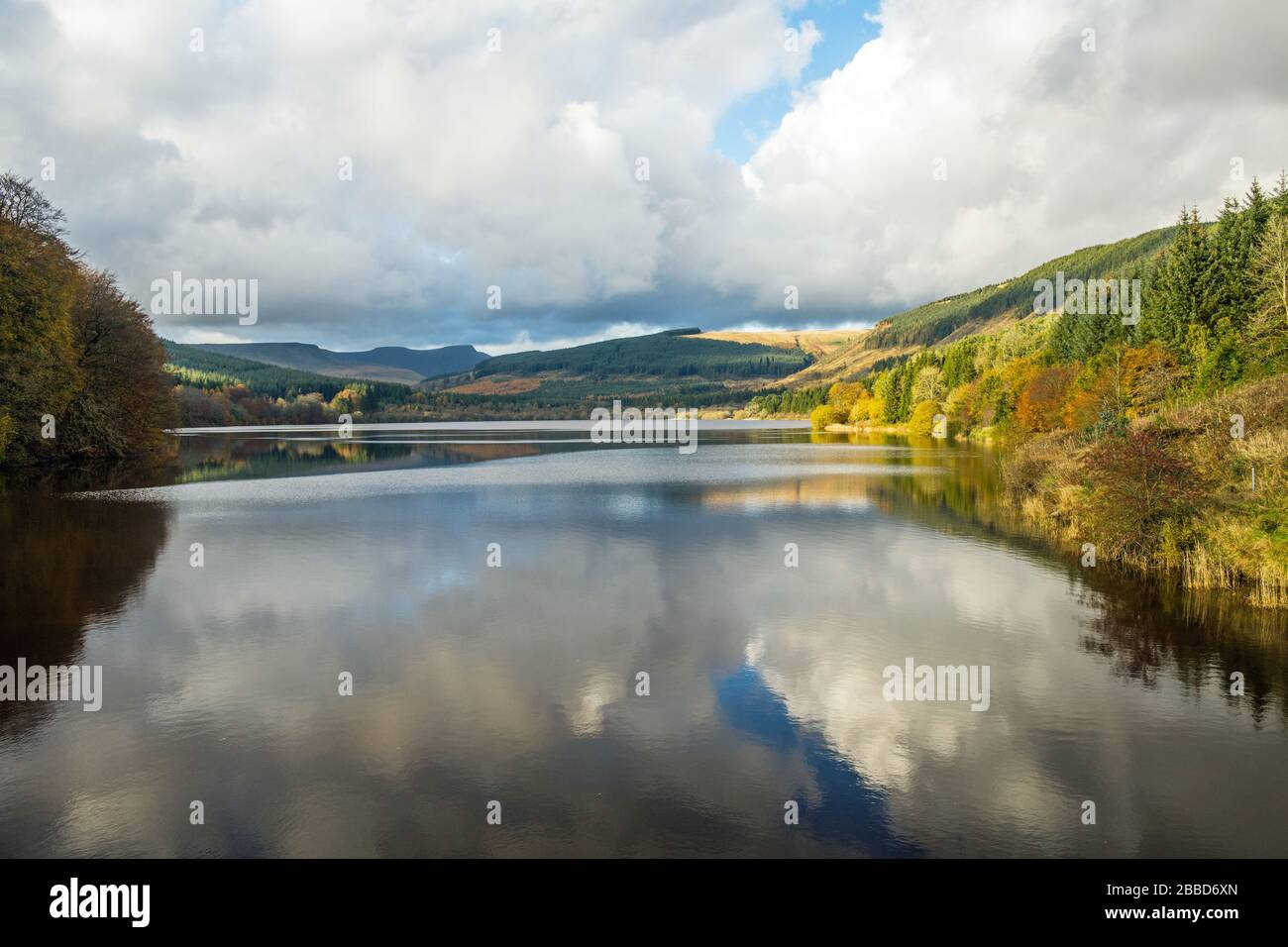 Dolygaer Reservoir in the Central Brecon Beacons South Wales in autumn showing beautiful cloud reflections in the reservoir. Stock Photo